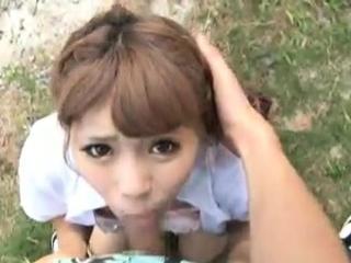 Asian lay gives outdoor blowjob